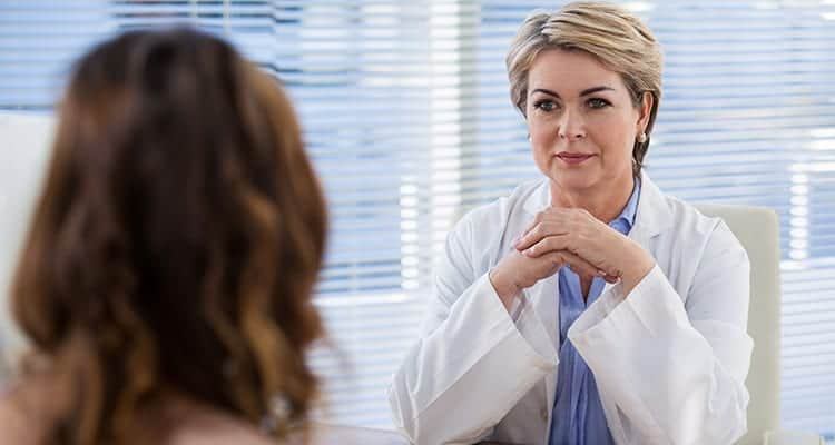 Patient consulting a doctor at the hospital-What are the side effects of cbd. cbd negative side effects.