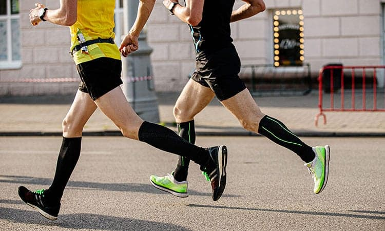 two men runners in athletic race. best cbd oil for athletes. Is cbd good for athletes? Does cbd for athletes help with inflammation and pain relief?
